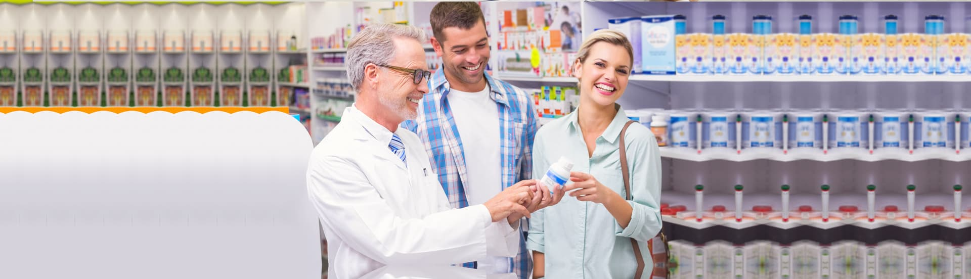 pharmacist holding medicine and smiling couple